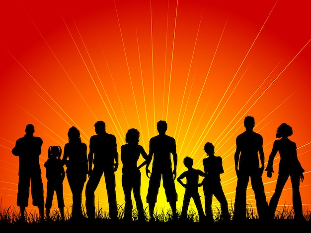 Silhouette of a large crowd of people against a sunset sky Free Vector