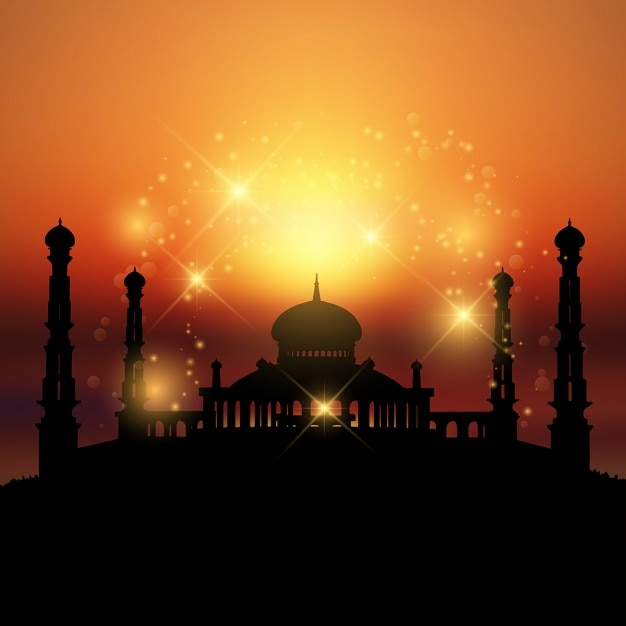 Silhouette of a mosque at sunset ideal for ramadan Free Vector