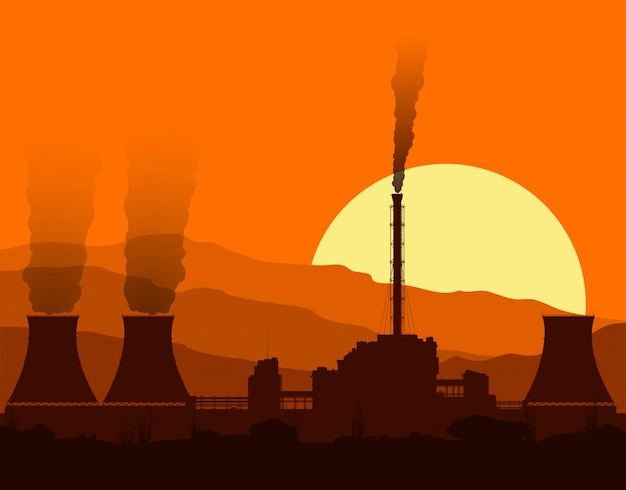Silhouette of a nuclear power plant at sunset. Premium Vector