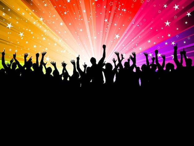 スターバーストの背景にパーティーの人々の群衆のシルエット 無料ベクター