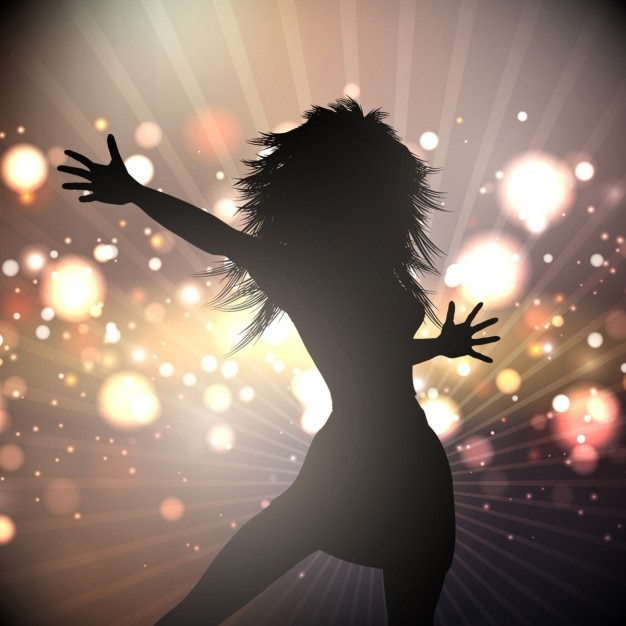 Silhouette of a female dancing on lights\ background