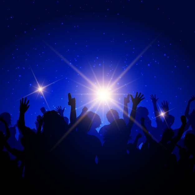 Silhouette of a party crowd on a night sky\ background