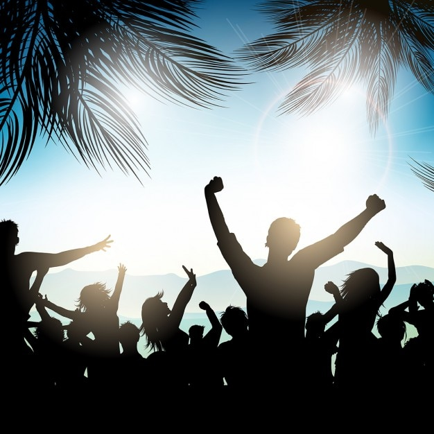 Silhouette of a party crowd on the beach