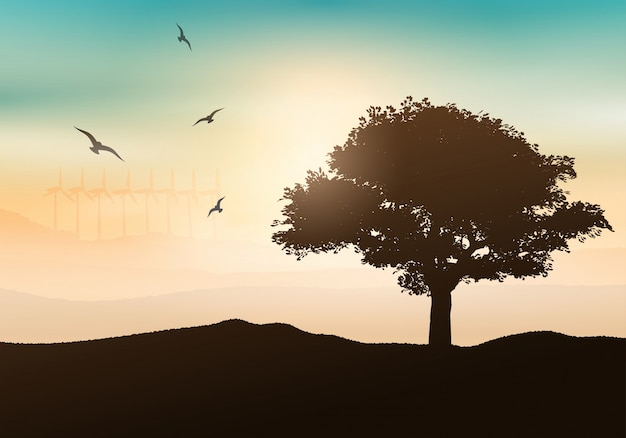 Silhouette of a tree against a sunset background with wind turbines Free Vector