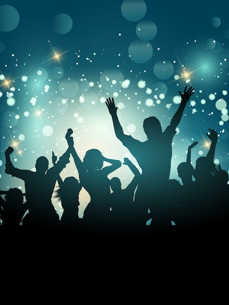 Silhouette of an excited party crowd on a bokeh\ lights background
