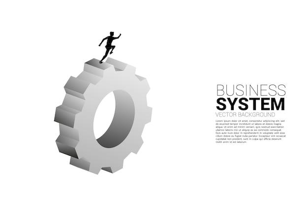 大きなギアで実行されているビジネスマンのシルエット。ビジネスの管理と制御の概念 Premiumベクター