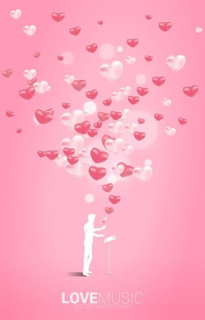 Силуэт дирижера, стоящего с ключом пианино с полетом воздушного шара сердца. концепция фон для песни о любви и темы концерта. Premium векторы