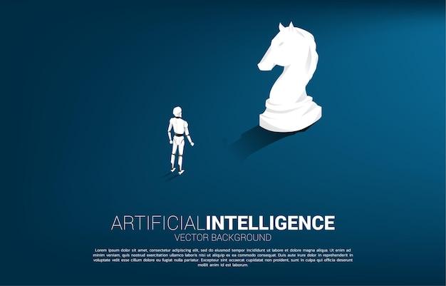 騎士のチェスの駒のシルエットで立っているロボットのシルエット。人工知能投資の概念。 Premiumベクター