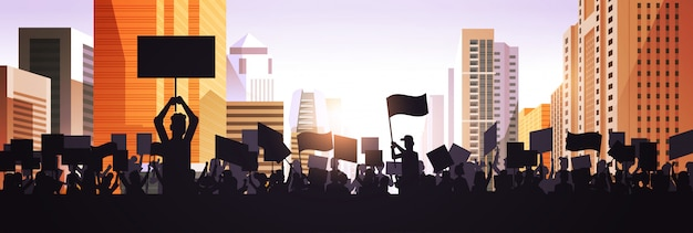 Silhouette of people crowd protesters holding protest posters men women with blank vote placards demonstration speech political freedom concept cityscape background horizontal portrait Premium Vector