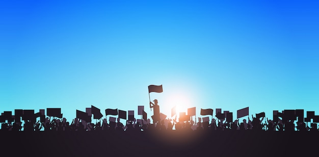 Silhouette of people crowd protesters holding protest posters men women with blank vote placards demonstration speech political freedom concept horizontal portrait Premium Vector