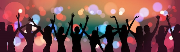 Silhouette people dancing over holiday firework background party celebration concept Premium Vector