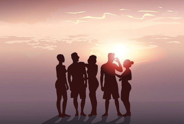 Silhouette people group stand man and woman full length over sunset background Premium Vector
