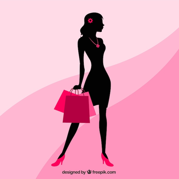 Silhouette of a woman with shopping bags Free Vector