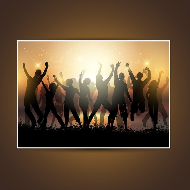 Silhouettes of a group of people dancing at\ sunset