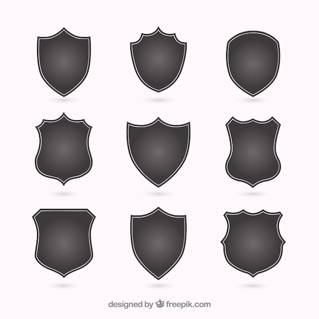 Silhouettes of different shields Free Vector