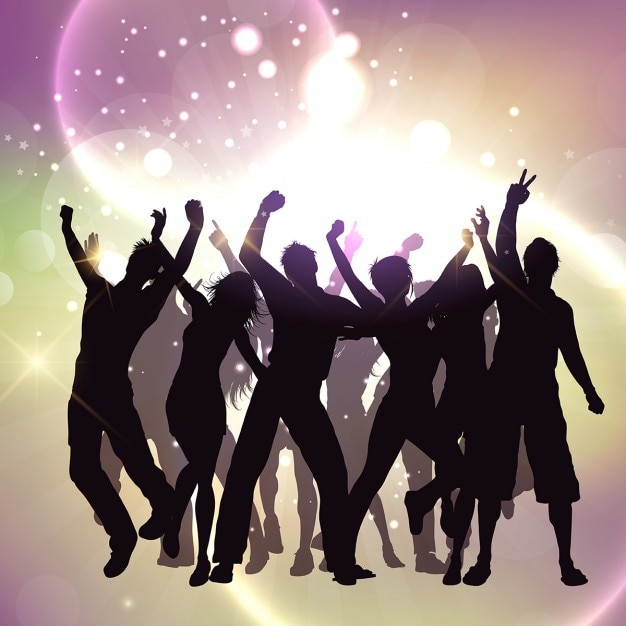 Silhouettes of people dancing on a bright\ background