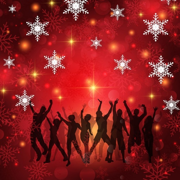 Silhouettes of people dancing on a christmas\ background