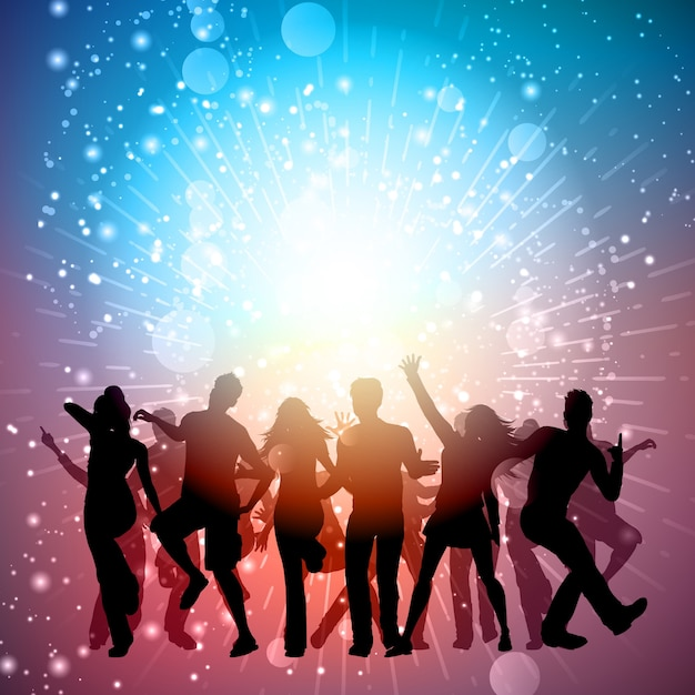 Silhouettes of people dancing on a starburst background Free Vector