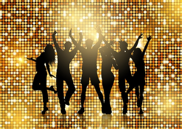 Silhouettes of people dancing on glittery gold\ background