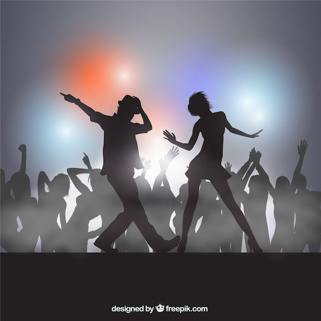 Silhouettes of people dancing Premium Vector