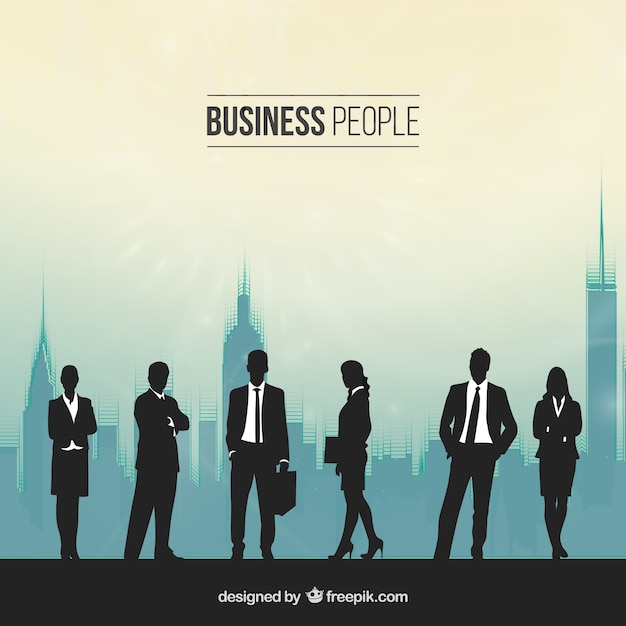 Silhouettes of people in a busy office Free Vector