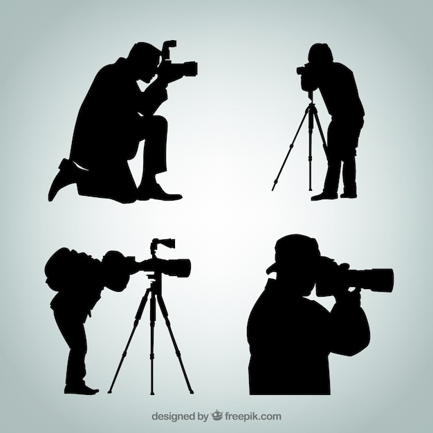 Silhouettes of photographer Free Vector
