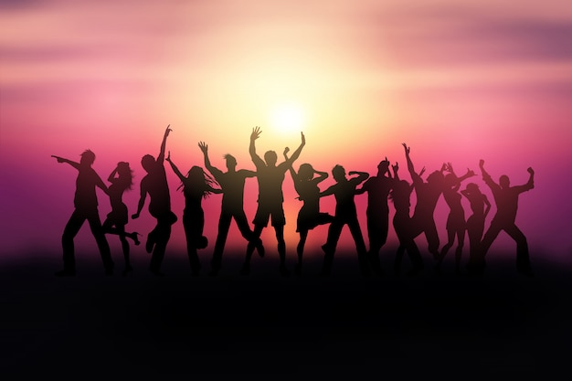 Silhouettes of people dancing in a sunset landscape Free Vector