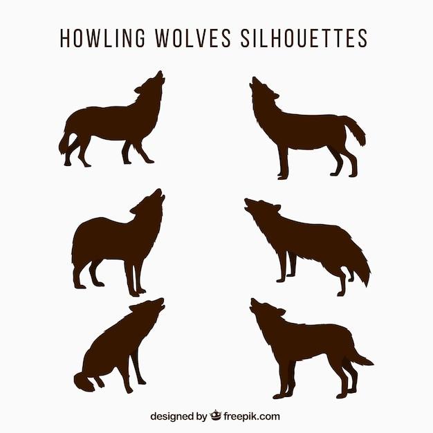 ハウリングのオオカミのシルエットセット 無料ベクター
