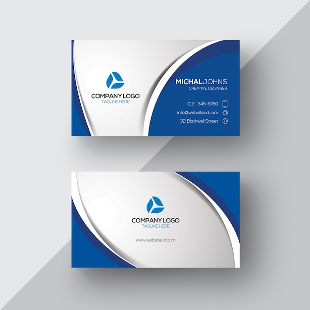 Silver and blue business card Free Vector