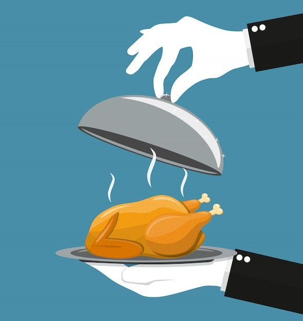 Silver cloche serving roasted chicken on plate. Premium Vector
