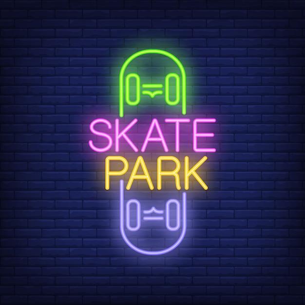 Skate park neon text on skateboard logo. Neon\ sign, night bright advertisement