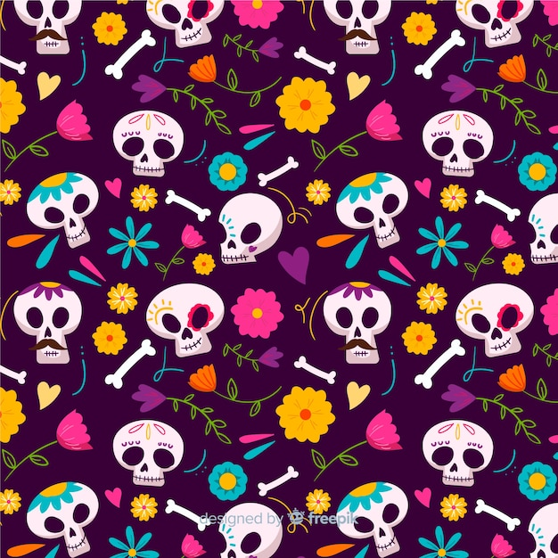 Skulls seamless pattern in hand drawn design Free Vector