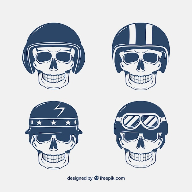 Skulls with hand-drawn helmets Free Vector