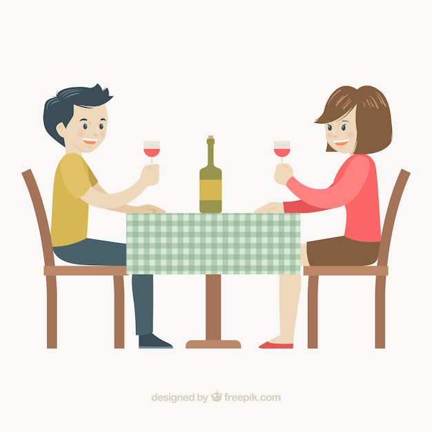 Smiley couple drinking wine in a restaurant