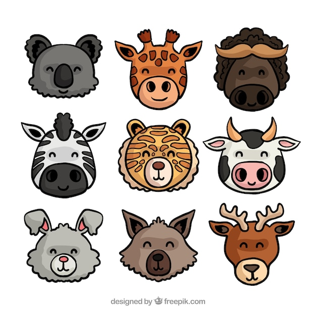 Smiley hand drawn animal  faces Free Vector