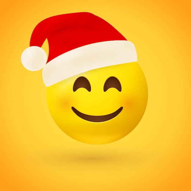 A smiling face emoji with red santa hat Premium Vector