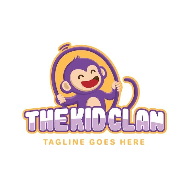 Smiling monkey kid logo Premium Vector