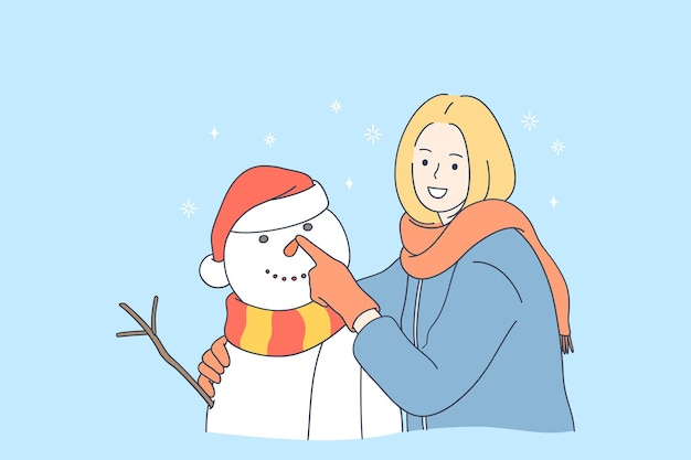 雪だるまを作って冬を楽しんでいる笑顔の女性漫画のキャラクター Premiumベクター