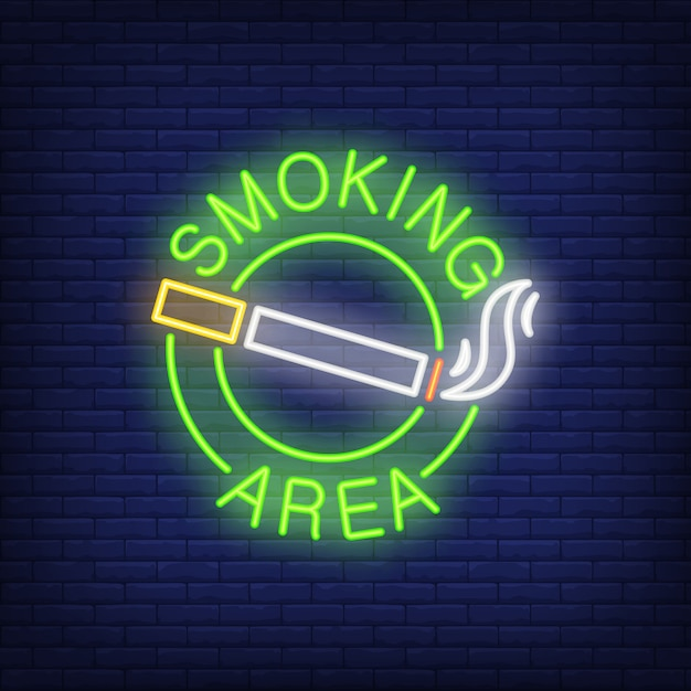 Smoking area neon sign. cigarette with smoke in round. night bright advertisement Free Vector