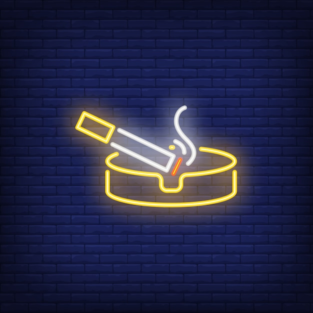 Smoking cigarette on ashtray neon sign Free Vector