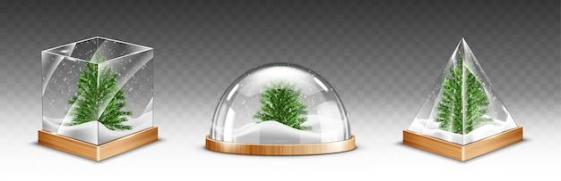 투명 한 배경에 고립 된 나무 기지에 크리스마스 트리와 스노우 글로브 무료 벡터