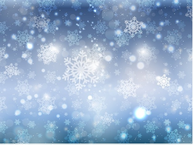 Snowflakes on a bokeh background Free Vector