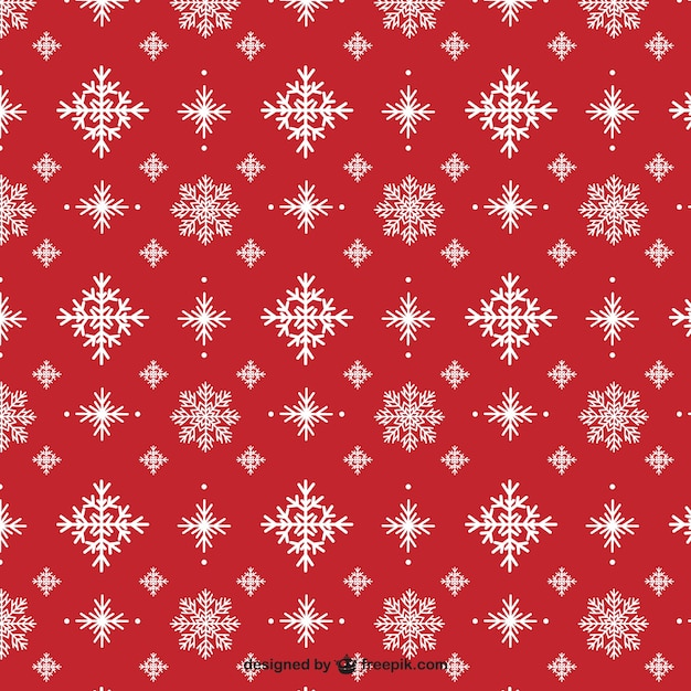 Snowflakes on a red background pattern Free Vector