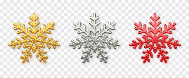 雪片セット。キラキラテクスチャが分離された輝く金、銀、赤の雪片 Premiumベクター