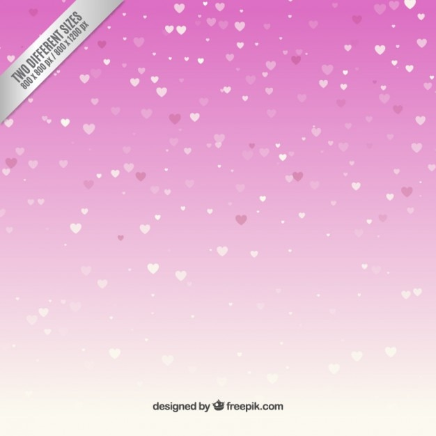 Snowing hearts over pink background