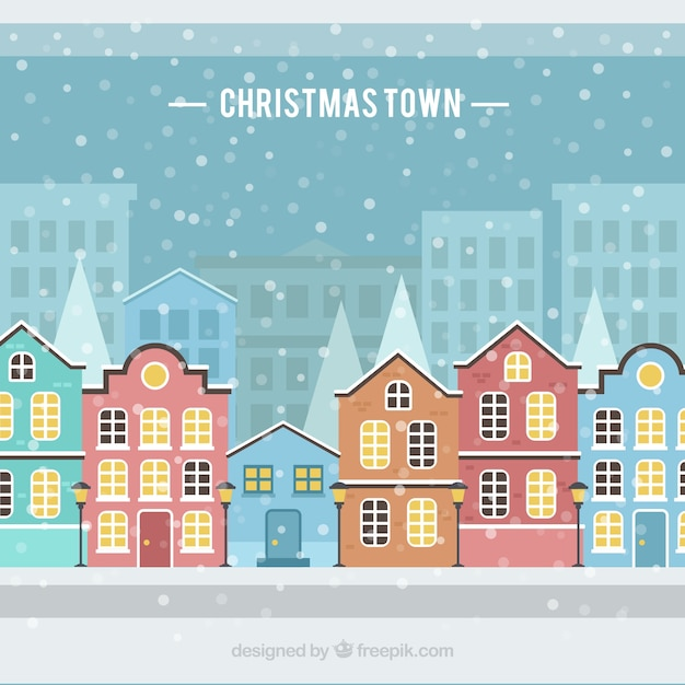 Snowing in a christmas town Free Vector