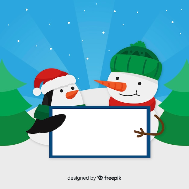 Snowman and penguin holding blank sign Free Vector