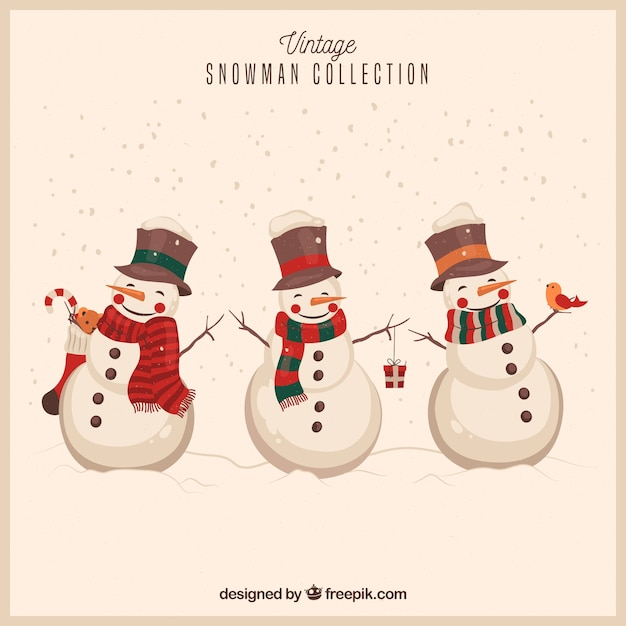 Snowmen background in vintage style Free Vector