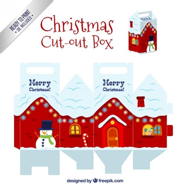Snowy christmas house box Free Vector