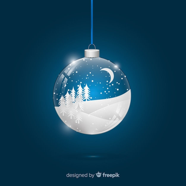 Snowy field realistic christmas ball Free Vector